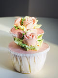 Cup cake dessert with Rose and flower decoration Stock Image