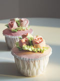 Cup cake dessert with Rose and flower decoration Stock Photography