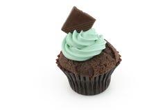 Cup cake with green cream Stock Photos