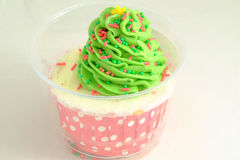 Cup cake with green icing and candies Royalty Free Stock Photography