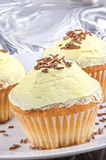 Cup cake with lemon buttercream Royalty Free Stock Photos