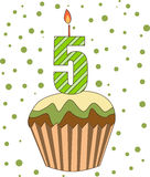 Cup cake with numeral candles Stock Images