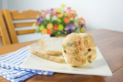 Cup cake with pumpkin seeds and currant with blue fabric Stock Images