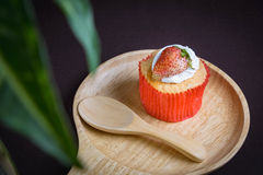 Cup cake strawberry. On brown background Stock Photos