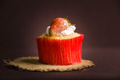 Cup cake strawberry. On brown background Stock Photography