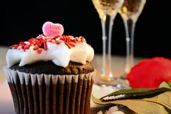 Cup cake topped with heart Royalty Free Stock Image