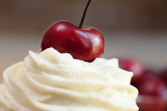 Cup cake topping with cherry Stock Photos