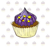 A cup cake with violet icing Stock Photography