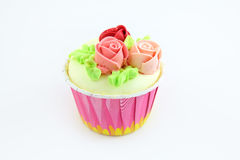 Cup cake on a white background. Cup cake sweet cream rose flower Royalty Free Stock Image