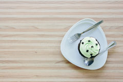 Cup cake on wooden table in coffee shop.  stock photography