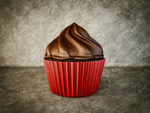 Cup-cake. Yummy cup-cake isolated on a scratched background Royalty Free Stock Photo