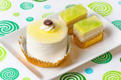 Cup cakes. Close up off two different cupcakes on a plate Royalty Free Stock Image