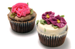 Cup cakes. With flower frosting Stock Photos