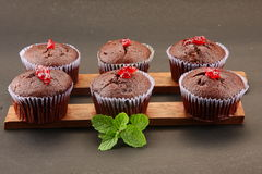 Cup cakes in black background,.with  topping Royalty Free Stock Photo