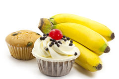 Cup cakes and bunch of bananas Stock Image