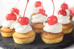 Cup cakes with cream and cherry Stock Photography