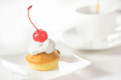 Cup cakes with cream and cherry Stock Photo