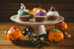Cup cakes with decorations on table during Halloween. Cup cakes with decorations on wooden table during Halloween Royalty Free Stock Photography