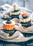 Cup cakes Halloween. Cup cakes for Halloween decoration on wooden background,selective focus Royalty Free Stock Photography