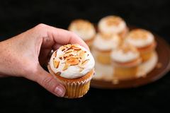 Cup cakes held female hand plate cup cakes Stock Photography