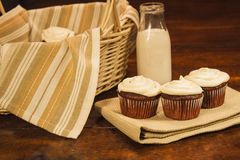 Cup cakes and milk Stock Image