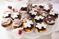 A cup cakes with pieces of puzzles stock image