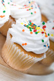 Cup cakes on a silver plate Royalty Free Stock Photography