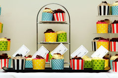 Cup cakes on stands close-up stock photos