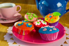 Cup cakes with tea Stock Image
