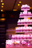 Cup cakes in wedding party. With pink lighting Stock Photo