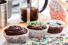 Cup cakes on a wooden surface. Cup chocklate cakes on a wooden surface Royalty Free Stock Images