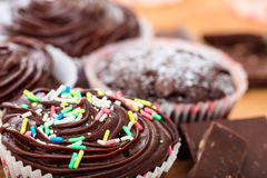 Cup cakes on a wooden surface. Cup chocklate cakes on a wooden surface Stock Photos