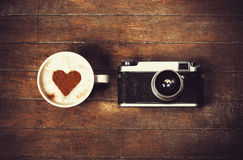 Cup with camera Royalty Free Stock Images