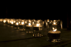 Cup candle light in the small cup in a row Stock Photos