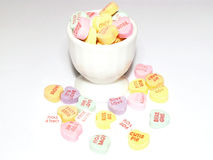 Cup of candy hearts. A cup of candy conversation hearts royalty free stock photography