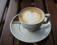 Cup of cappucchino. Over wooden table Stock Photo