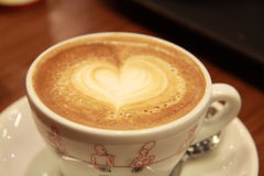 Cup of cappuccino. With a heart on top made of foam Stock Images
