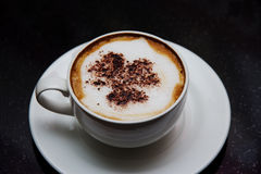 A cup of Cappuccino. A cup of hot coffee Royalty Free Stock Photos