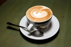 Cup of cappuccino. On the cafe table royalty free stock photography