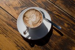 Cup of cappuccino. On the table royalty free stock photography