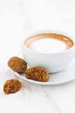 Cup of cappuccino and almond cookies, vertical, selective focus Stock Photo