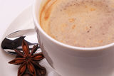 Cup of cappuccino and anise Stock Photos