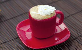 Cup of cappuccino on a bamboo mat Royalty Free Stock Photo