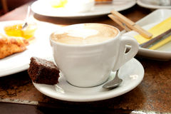 A cup of cappuccino with a beautiful crema. Shooting in the cafe Royalty Free Stock Photo