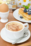 Cup of cappuccino, belgian waffles with blueberries and egg Royalty Free Stock Image