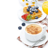 Cup of cappuccino, belgian waffles with blueberries Stock Photo
