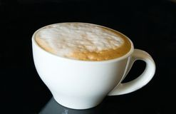 Cup cappuccino on the black Royalty Free Stock Photos