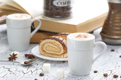 Cup of Cappuccino and cake Royalty Free Stock Photos