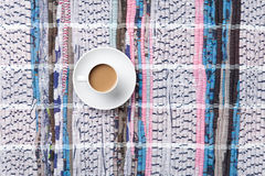Cup of cappuccino on carpet Royalty Free Stock Photography