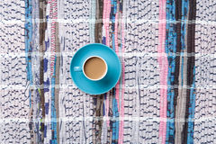 Cup of cappuccino on carpet Stock Image